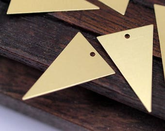 Gold metal charms of triangle shape