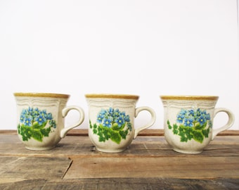Set of Three Mikasa Garden Club 'Bells of Blue' Stoneware Mugs. Rare pattern from the late 70's with vibrant bluebell flowers. More in shop!
