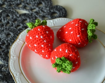 Little handmade amigurumi strawberry, cute crochet food decorative ornament.