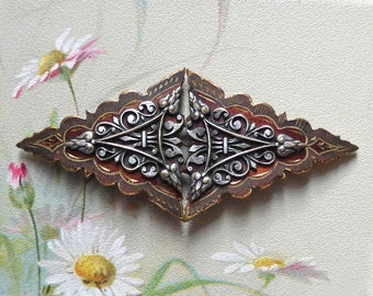 Clasp/buckle, antique.  An elongated diamond, decorative pierced metal, hand chased, champleve enamel/rust-brown. c1890.