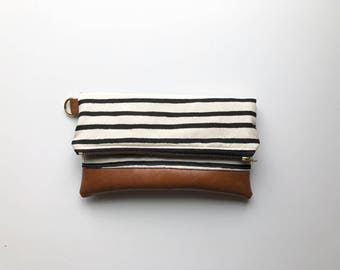 Black and white striped clutch with brown faux leather
