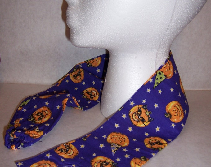 Pumpkins in masks, fabric stethoscope cover