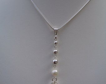 Y necklace in sterling silver with a super long trailer