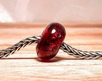 Ruby red with glitter handmade lampwork glass bead.
