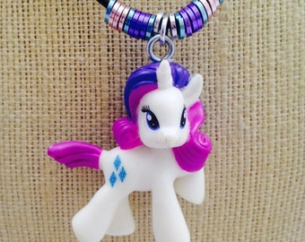 Rarity (My Little Pony) Mini Figure Character Necklace. Small figure on embellished leather cord necklace.