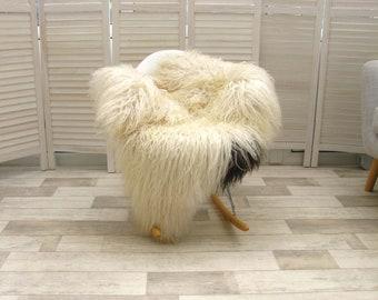 Genuine curly cream white with black spot Icelandic single sheepskin rug | large & luxurious | 120cm x 80cm | G022