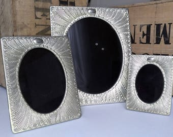Set of three photo frames in embossed metal - stunning