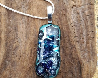 A stunning silver river fused glass pendant.
