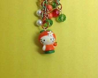 Kitty dressed as an orange cell phone charm, Kawaii charm, dust plug charm, dust plug, phone charm, headphone jack charm,  iphone charm