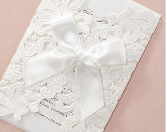 Pearl white floral wrap wedding invitations with ribbo