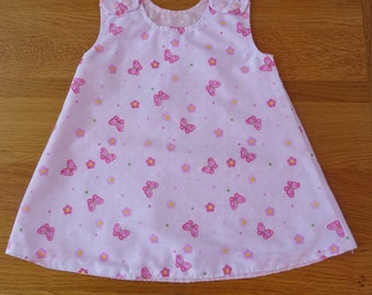 Pink and White Butterfly reversible Girl's Dress.  1 to 2 yrs