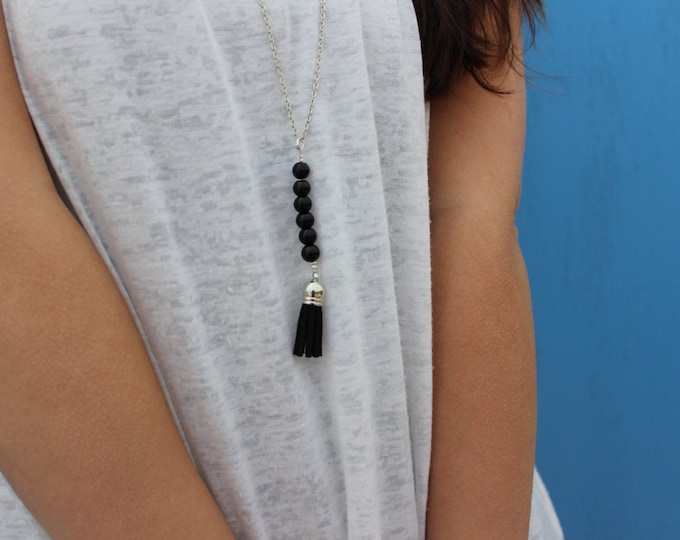 Black beaded tassel necklace.