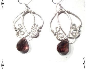 Earrings Silver 925/1000 and plum crystal.