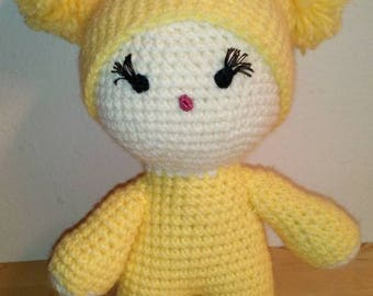 amigurumi doll with yellow hat.