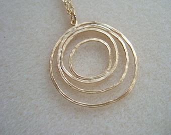 Gold Ripple Pendant Necklace