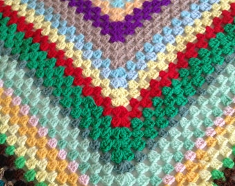 hand crocheted granny blanket very colourful