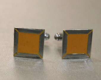 Yellow enamel and silver cufflinks