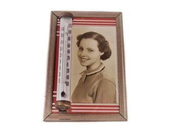 Antique vintage silver tone metal red stripe glass framed black and white B&W photographic picture of woman thermometer temperature gauge