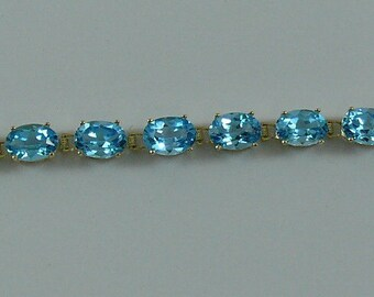 Blue Topaz Bracelet 7 Inches 14k Yellow Gold