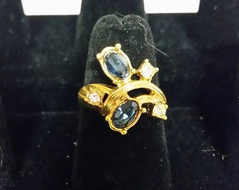 Goldtone ring with blue stones and accents
