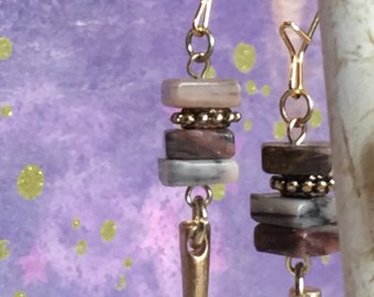 Modern contemporary boho chic fashionable Gemstone & Horn Dangle Earrings. Featuring gray-black gemstone shapes and a gold horn dangle.