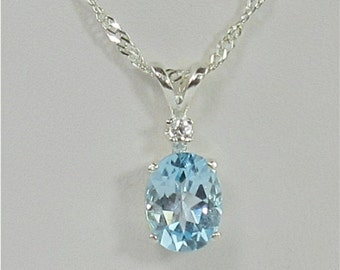 Sky Blue Topaz 9x7mm 2.15ct White Zircon Accent Sterling Silver Pendant Necklace
