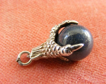 G) Vintage Sterling Silver Charm Grey marble orb in a dragons claw