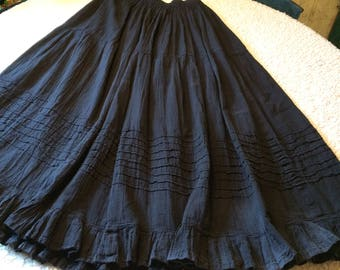 This Broom skirt in black was made by me in Oaxaca and Santa Fe New Mexico.  Very comfortable and easy care!