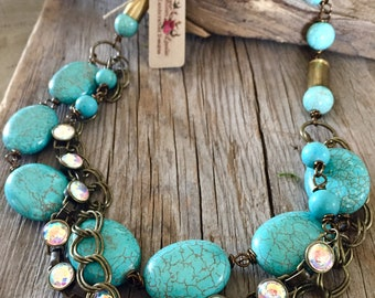 Chunky turquoise statement bullet necklace vintage rustic chic layered multi strand statement necklace joellie jewelry designs