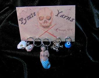 Treasures!  Assorted stitch markers,  Mermaids may vary, as they do.