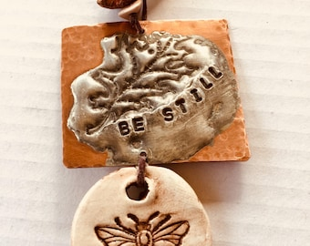 Soldered and clay ornament
