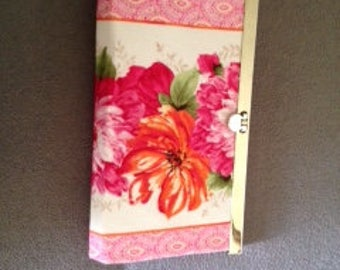 purse/wallet with gold metal frame and large red floral fabric.