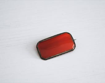 Rectangular rust red glass brooch, metal frame, Italy, 1920s