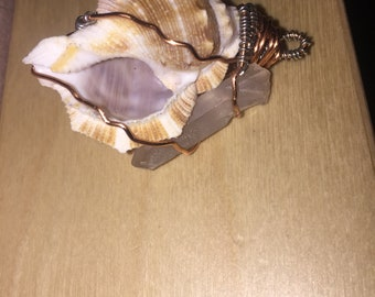 Wire wrapped shell with crystal