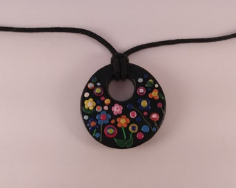 Floral polymer clay pendant on lariat rope necklace