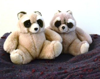"GUND RACOONS (two), VINTAGE "" 1985 "", 14"" head to tail, 10"" ear to backside. Tan, Dark Brown on Ears, Tail,& around eyes. Mint."