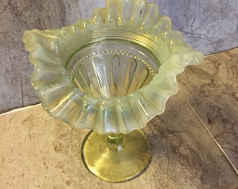 Small ruffled light green vase