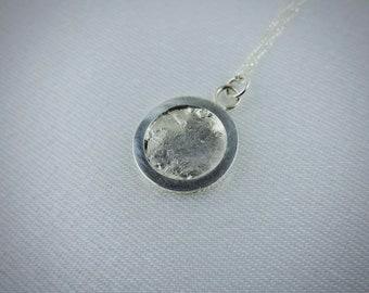 Framed Cast Silver Pendant