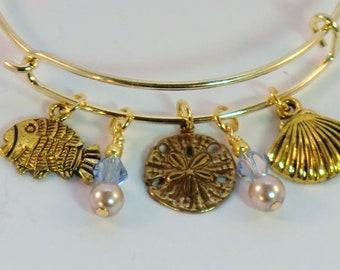 SALE! Gold and pale blue ocean charm bangle, beach and sea charms, starfish, fish, shell charm jewelry, stackable sea bangle, charm bangles