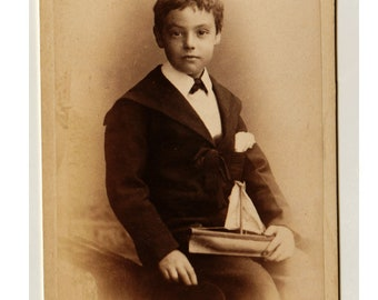 antique CDV photo - young boy posing with a wooden toy yacht - Brown, Barnes and Bell - Royal photographers Liverpool studio