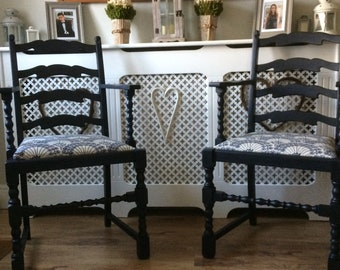 Pair of Ladder Back Carver Chairs with Re upholstered Seat.
