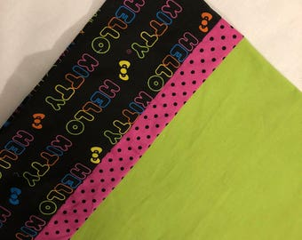 Hello Kitty Pillowcase Rainbow Words with pink and black dot trim and chartreuse body