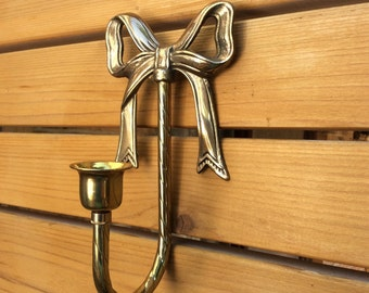 Vintage 7 inch brass ribbon sconce. Candle holder.