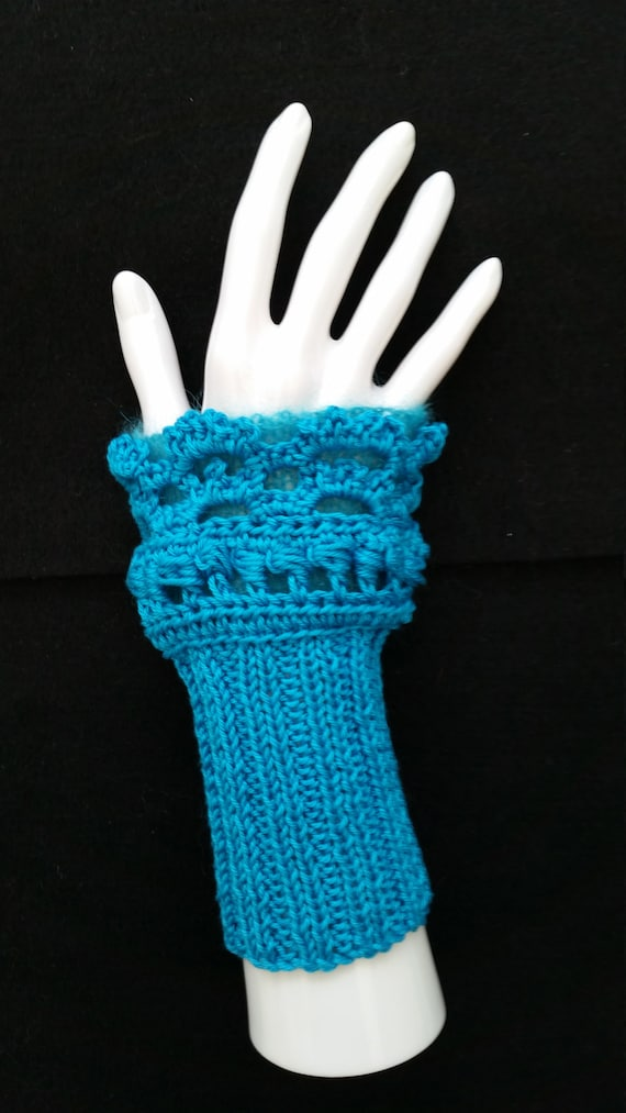 L224  Hand knitted wristlets with crochet finish