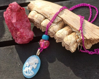 Blue skull cameo pendant on pink chain necklace