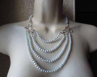White multi row necklace