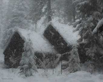 Snow covered cabin in woods