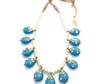 Pearls with the kundan embossed turquoise beads necklace