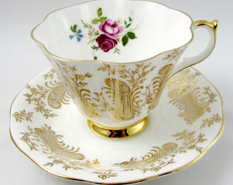Queen Anne Tea Cup and Saucer with Gold Decor and Flowers, Vintage Bone China