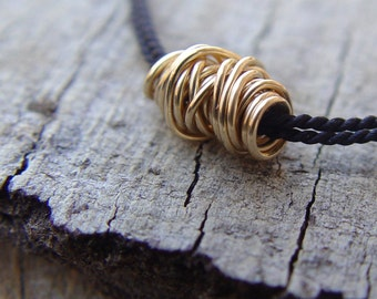 Gold Wire Ball on a Black Silk Necklace, Gold Necklace